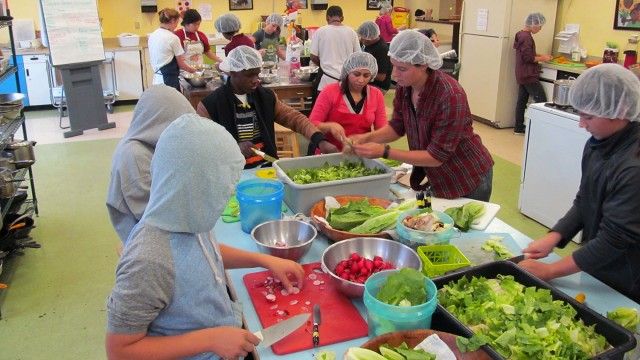 Seventh and eighth grade students at Willard Middle School work to prepare meals to sell. (Katrina Schwartz/MindShift)
