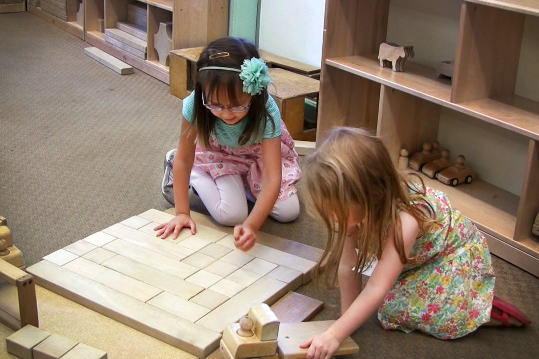Two girls play with blocks at Bing Nursery School at Stanford University. (Courtesy of Bing Nursery School)