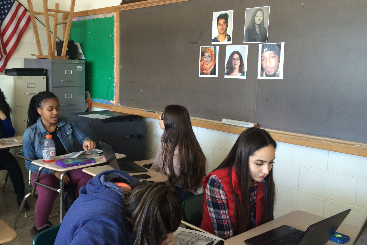 Students at Norwalk High School discuss the Serial podcast, while images of key players loom on the wall, including Adnan Syed and Sarah Koenig. Credit: Credit: Sabrina Hiller.