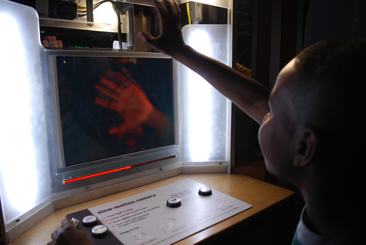 Taivon Wilson, a sixth-grade student at Franklin Middle School in Vallejo, Calif., waves at a high-speed camera that plays back movements in extreme slow motion during a field trip to The Exploratorium.