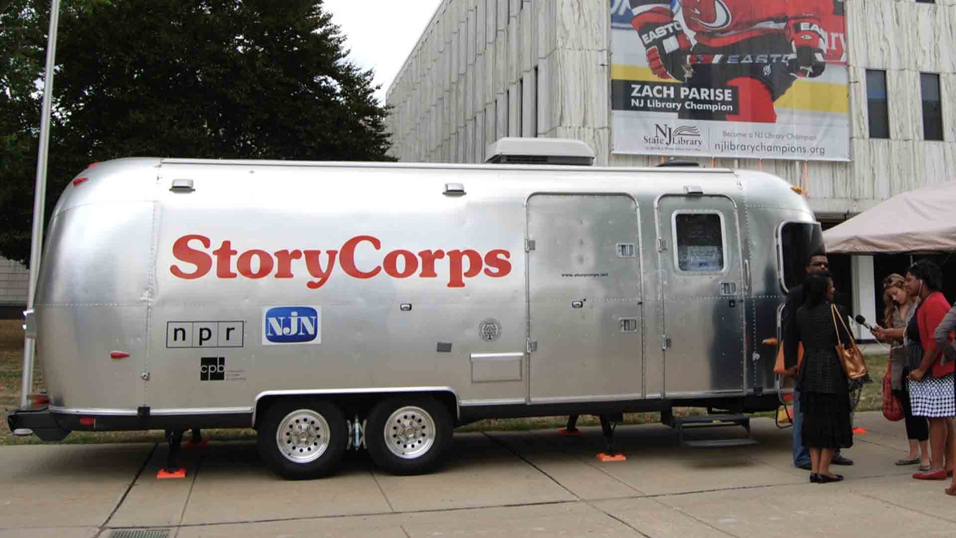 A StoryCorps mobile recording booth in front of the New Jersey State Library.