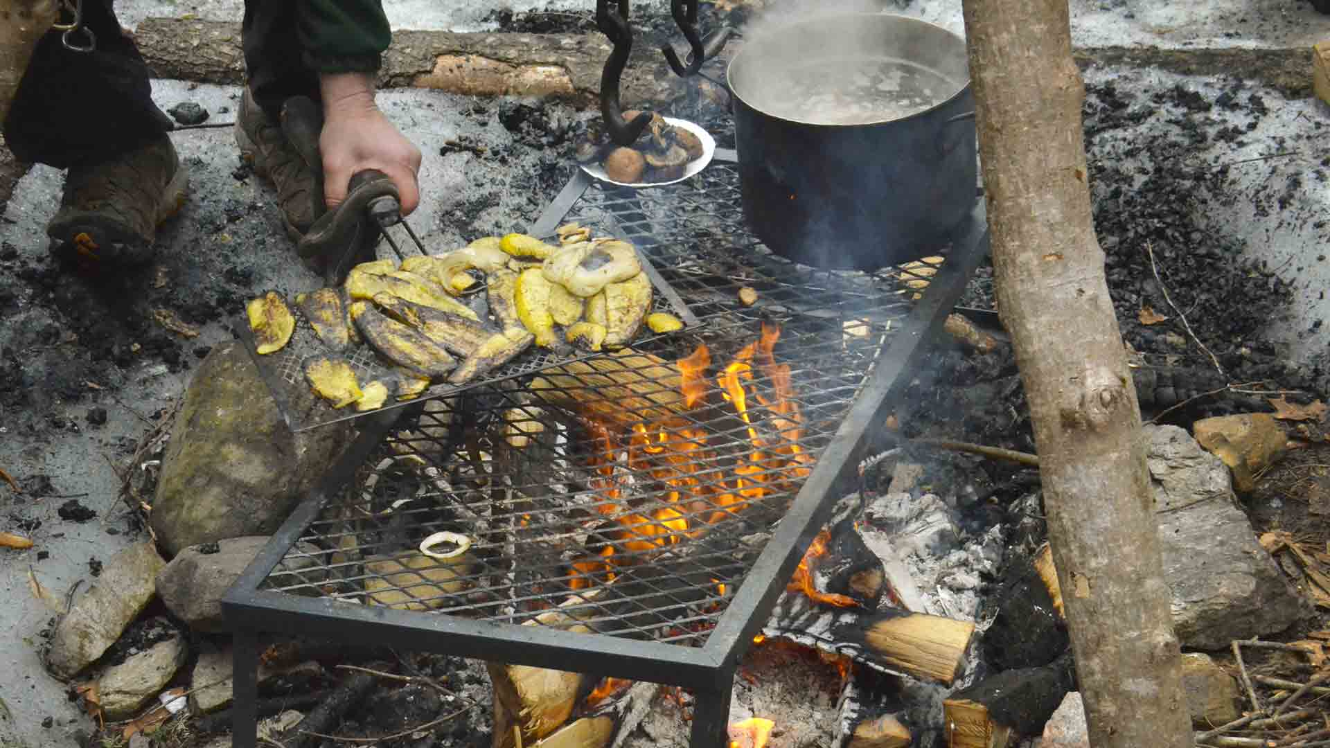 "Grilling snack for Forest Monday. Out in the woods, the kindergartners will ""try everything we put in front of them,"" says a teacher."