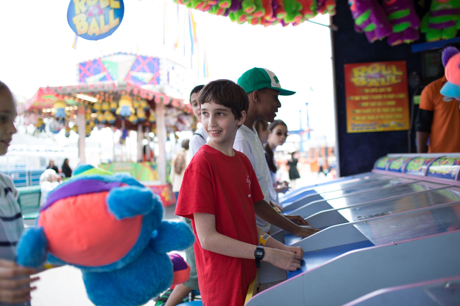 Student Etai Kurtzman, 12, wins a bear at the Roll-A-Ball game at Coney Island in Brooklyn, NY May 28, 2015. The group of students from Quest to Learn School took the day trip to Coney Island to analyze user experience on games and rides at Luna Park as part of  their late-spring school curriculum.
