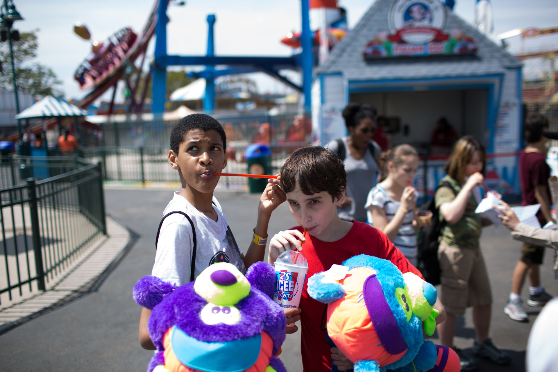 Students Terrell Gantt, left, and Etai Kurtzman, 12, share an Icee during a class trip to Coney Island in Brooklyn, NY May 28, 2015. The group of students from Quest to Learn School took the day trip to Coney Island to analyze user experience on games and rides at Luna Park as part of  their late-spring school curriculum.