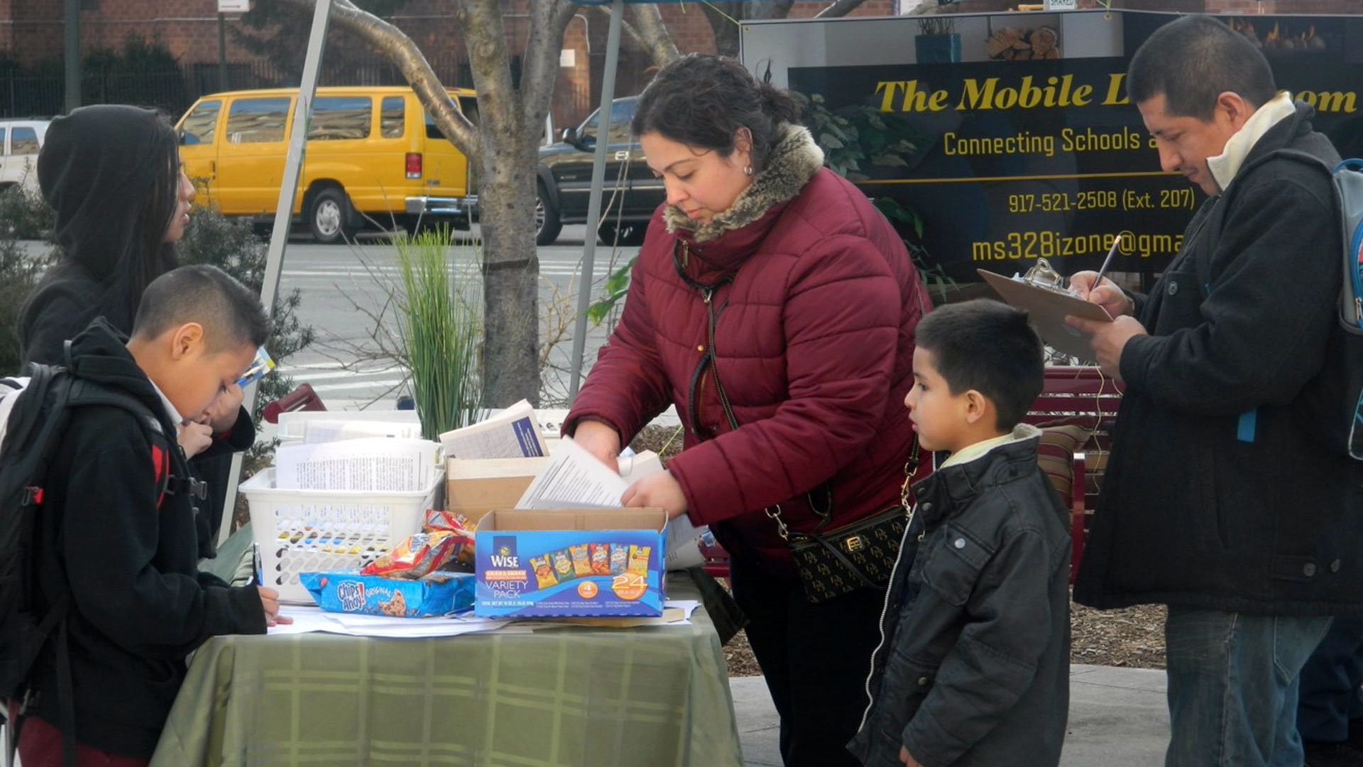 "MS 328 staff in Washington Heights tried to engage with parents in a new way by setting up ""mobile living rooms"" after learning that many parents were hesitant to enter school buildings after negative experiences there."