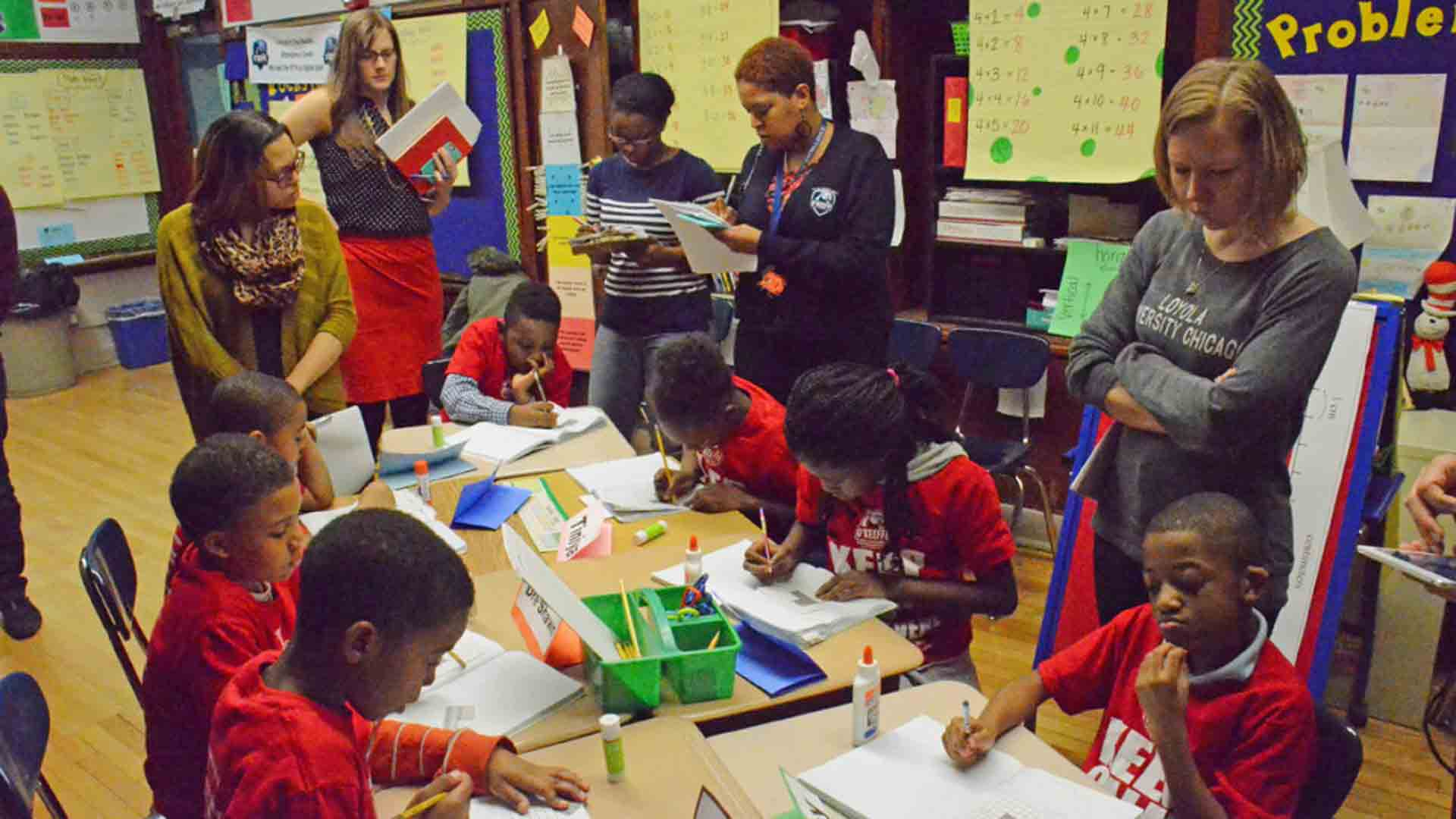 Teachers observe children working on a math problem during a public research lesson at the O'Keeffe School of Excellence in Chicago, January 2015.