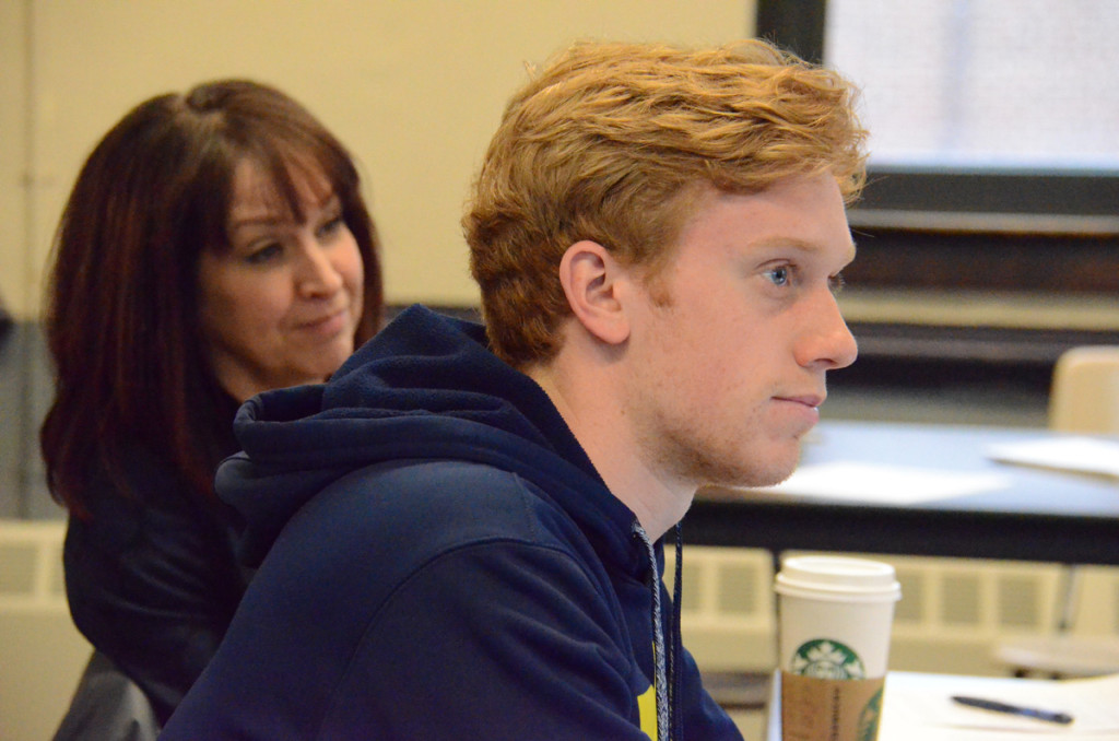 Lucien Gerondeau, a student in the Secondary Teacher Education program at the University of Michigan. Behind him is Elizabeth Moje, a professor and associate dean.