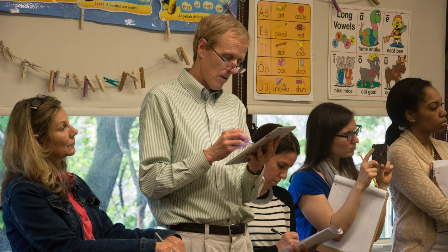 Several teachers observe one lesson, taking notes on Lesson Note or paper if they are newer to the process.