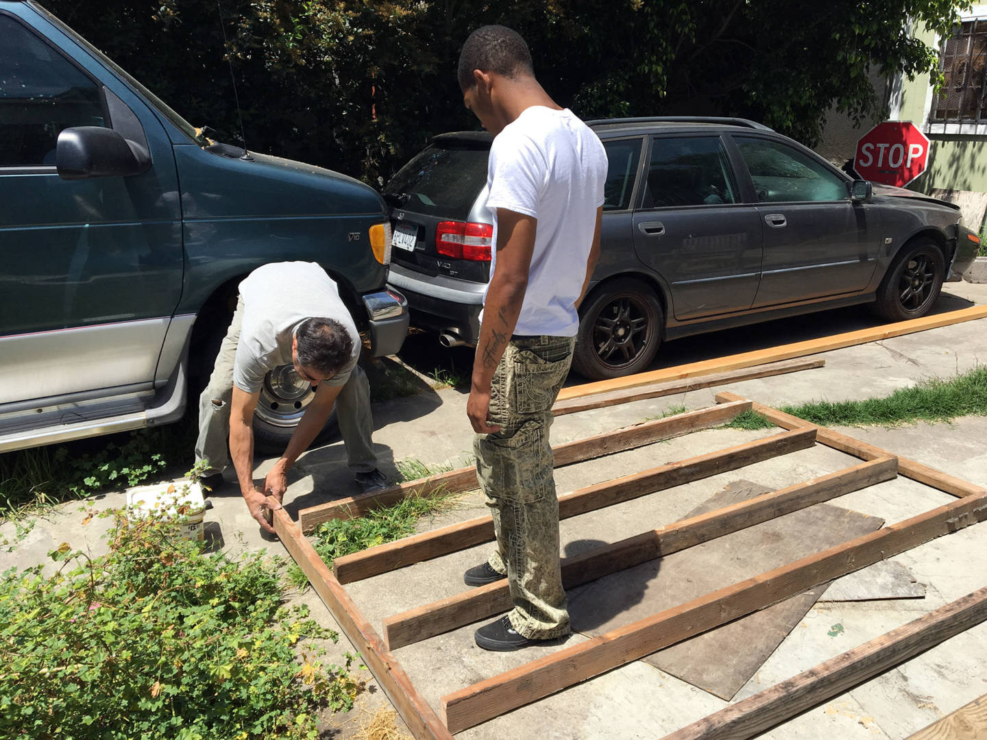 Rubenzahl helps McCoy put the finishing touches on the framing for a closet they are building.