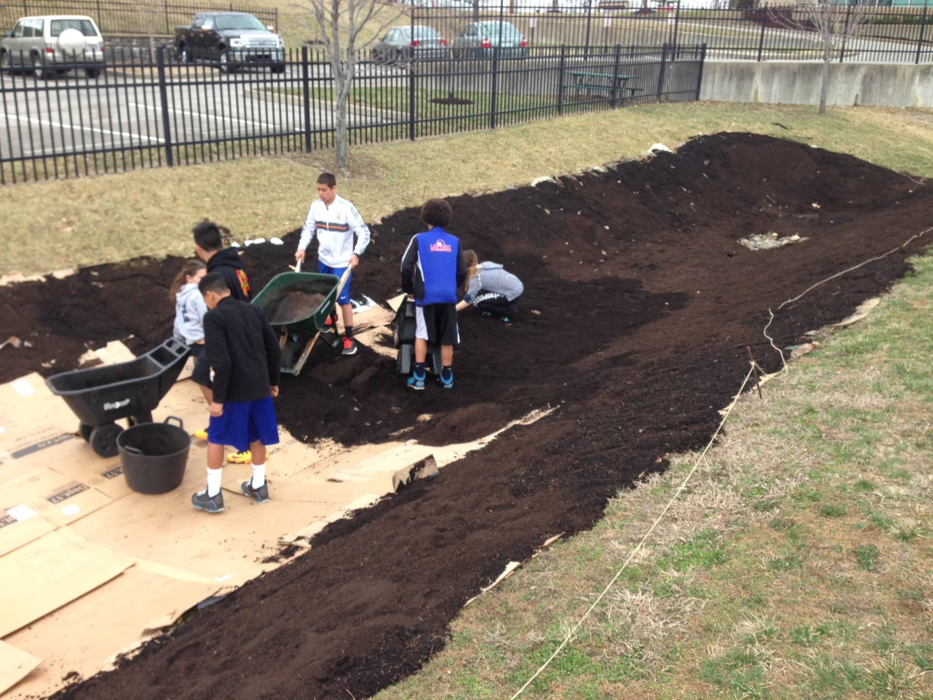 "This was my sustainability class preparing the grounds for a 1200 sq ft rain garden installation. The students designed the garden, calculated the amount of soil, researched native prairie plants, prepared the seeds using a treatment called ""cold stratification"" to mimic Missouri winters, delivered their proposal for the superintendent/board, and then installed the garden. 100ft long and 20ft wide. In addition to the positive effects on the watershed, the rain garden also served as a pollinator garden and used in longitudinal data collection on pollinators in our campus gardens."