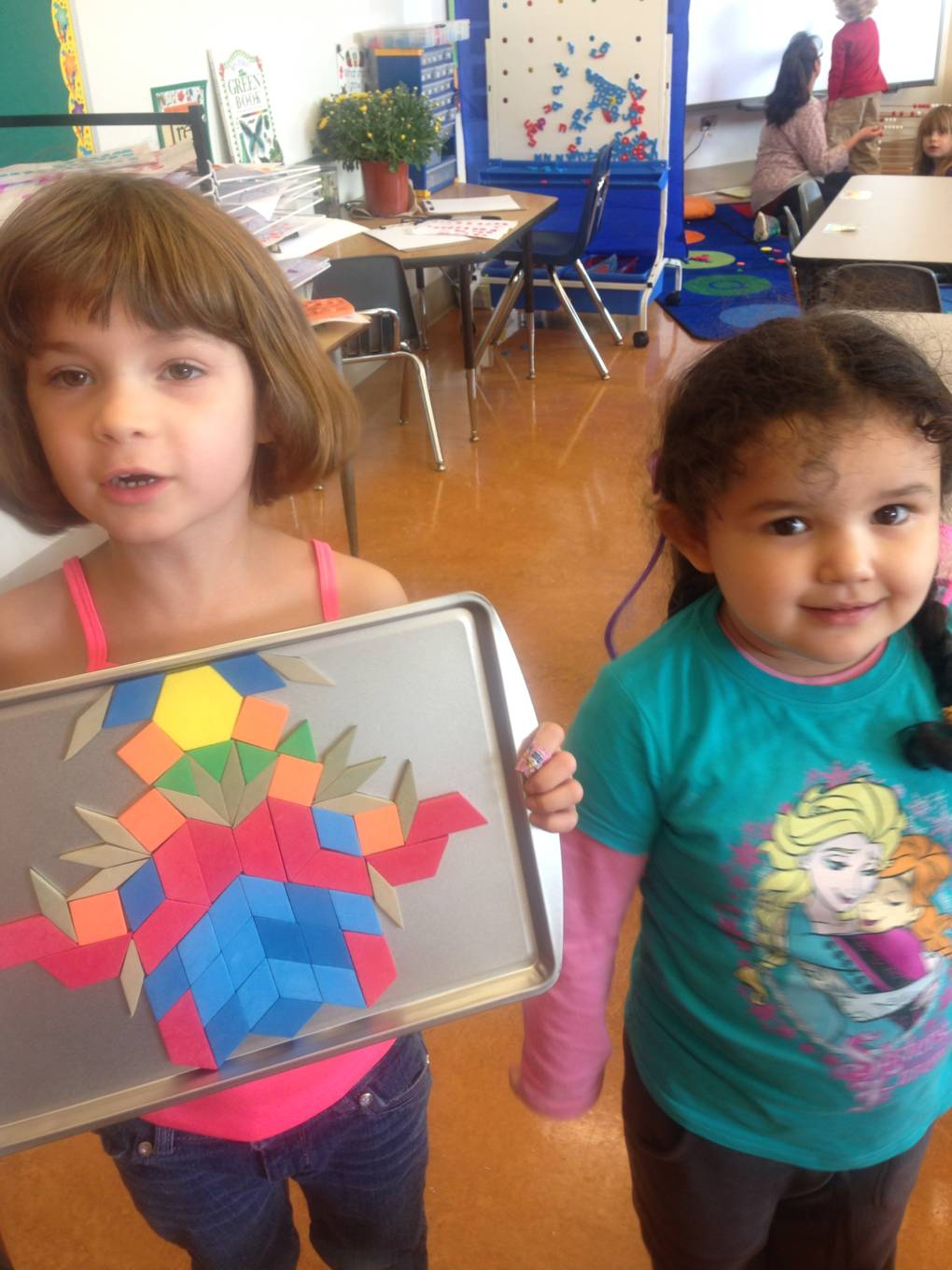 Students in Cristol Bailey's early years class show off their symmetry.