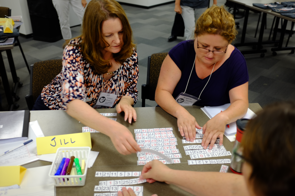Teachers at the Crooked River Math Teachers' Circle Summer Institute grapple with a problem.