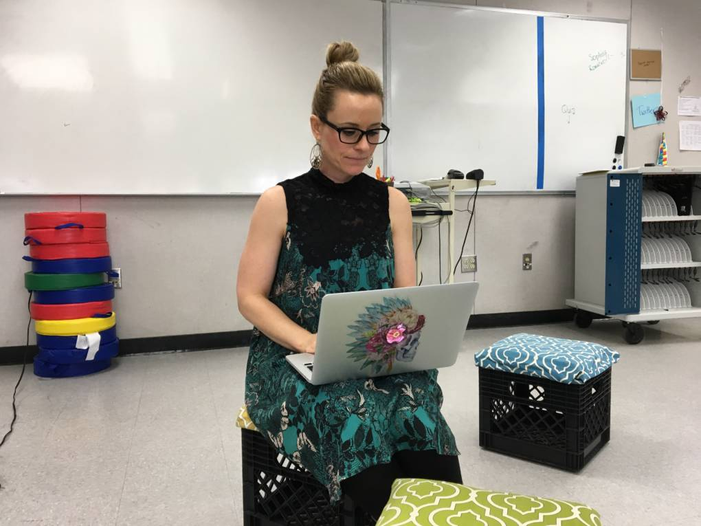 Catlin Tucker sits on moveable seats that her students created to add flexibility to their classroom.