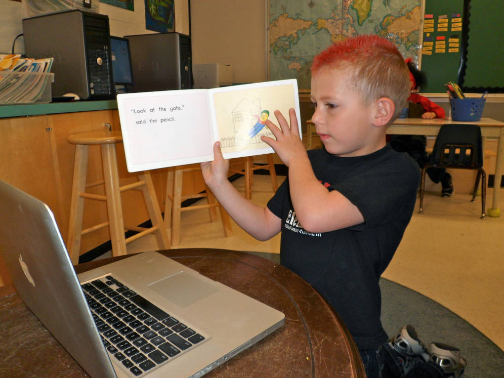 A student practices reading with his Skype partner.