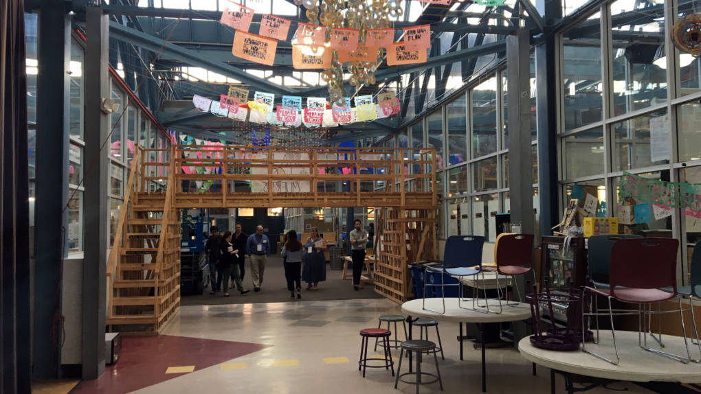 """A High Tech High hallway features part of an art project, """"Bridge to Nowhere,"""" along with many other examples of student work."""