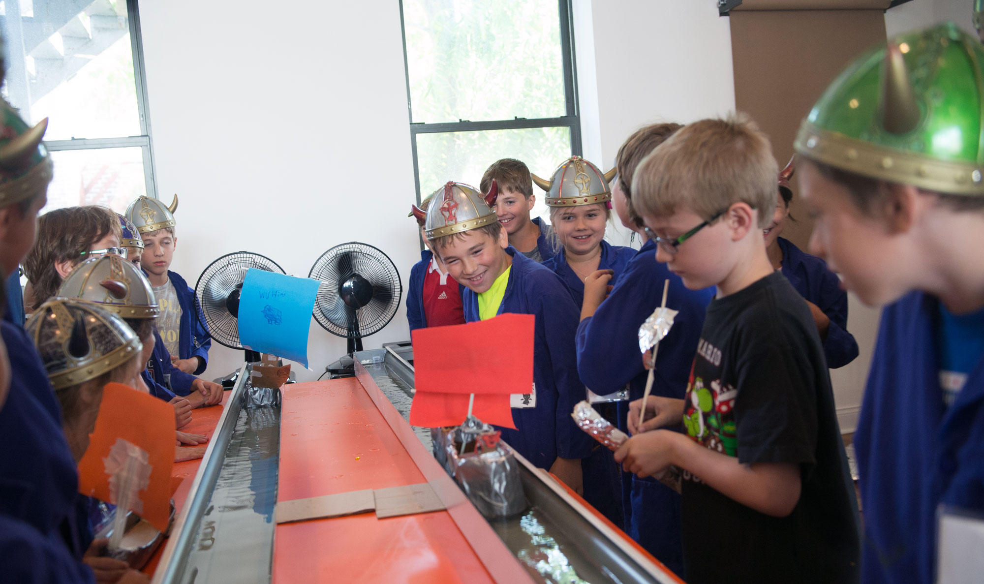 "During ""On Training Your Dragon"" camp, students learn about the Vikings and the science behind dragons and magical species. They used Newton's laws of motion and design-thinking to create a better Viking boat, testing it out in racing challenges against other clans."
