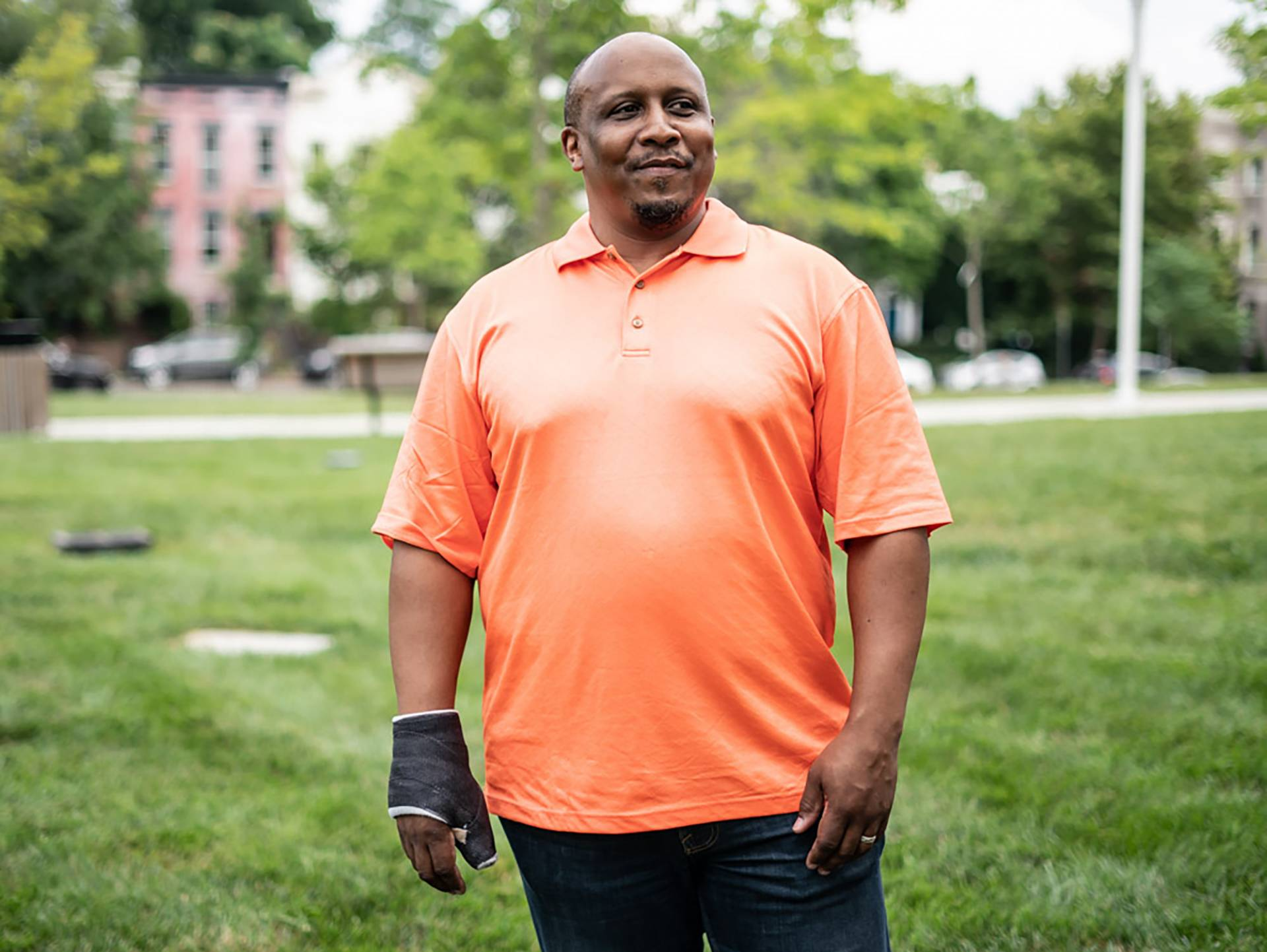 """Thom Woodward stands in front of Duke Ellington School of the Arts located in Washington, D.C. where he teaches. Woodward guided his student Jonetta Harrison, Makiyah Hicks and Quin Wells in creating the first podcast title """"Loss and Transformation."""""""