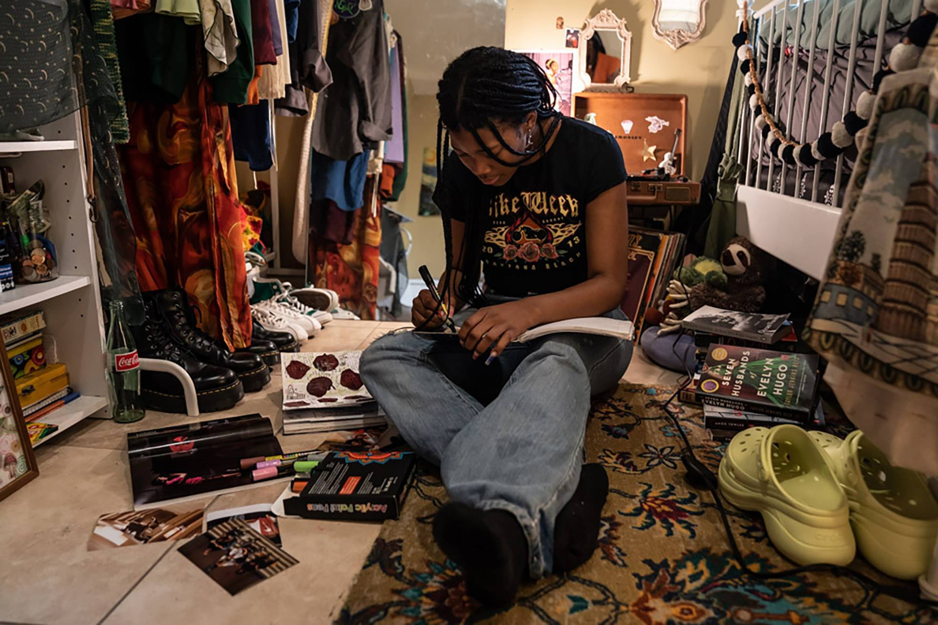 """Makiyah Hicks, sits in her bedroom where she recorded her part of the podcast """"Loss And Transformation."""""""