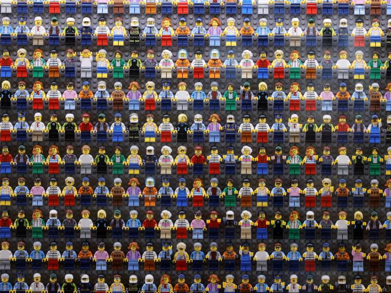 A wall of LEGO minifigures is encased inside the lobby of the LEGOLAND New York Hotel, pictured on Aug. 6 2021 in Goshen, New York. The Danish company is pledging to remove harmful stereotypes from its products and marketing.