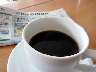 cup of coffee with the ONION