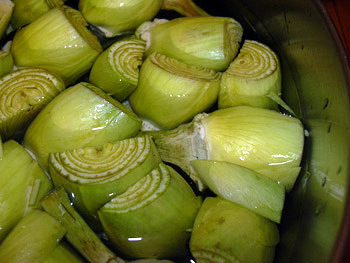 toss artichokes in acidulated water