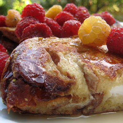 cream cheese and jam stuffed challah french toast with raspberries