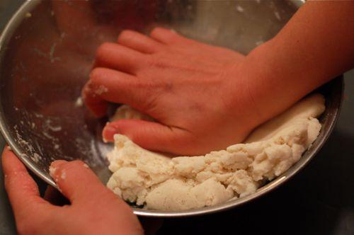 kneading arepas