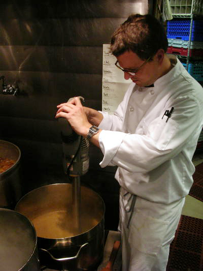 Brian Murphy, a sous chef at Oliveto, mixes up lentils for one of his signature soups.