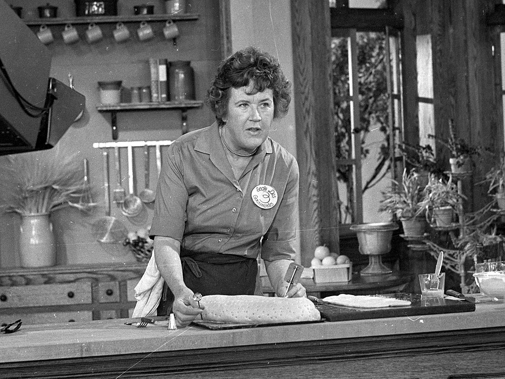 In this 1970 photo, Julia Child prepares a French dish in her TV kitchen.