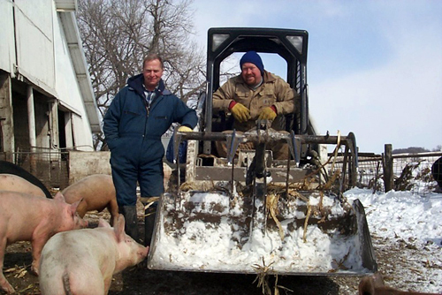 Paul Watson, seen left, heads a network of 500 small farmers who supply pork to Niman Ranch.