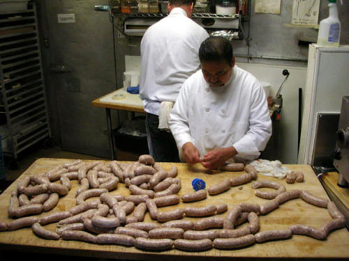 Oliveto butcher Pablo Tigre Mendoza Gavito prepares sausage in the back kitchen.