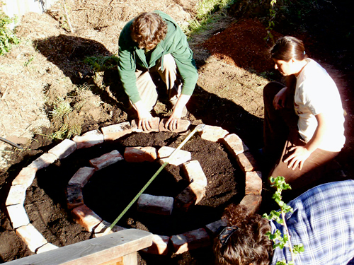 Building the herb spiral. Photo by Sally Carter.