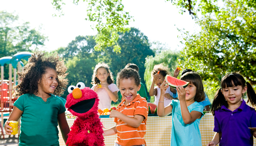 Elmo and kids have a great time enjoying fruits and vegetables as part of Sesame Street's Food For Thought initiative. © 2010 Sesame Workshop.  Photo by: Gil Vaknin.