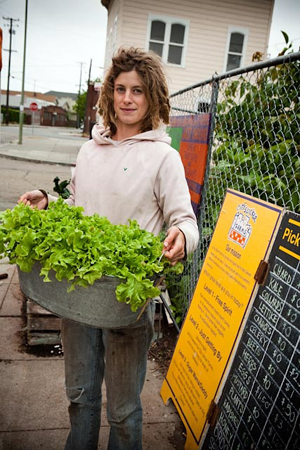 Adelle Martin readies the lettuce for the City Slicker sliding scale market table