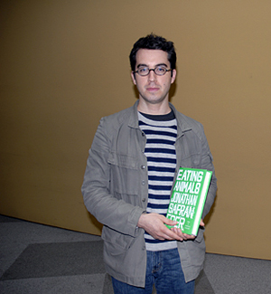 Jonathan Safran Foer at KQED holding his  book, Eating Animals. Photo by Wendy Goodfriend
