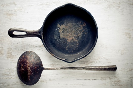 vintage cast iron skillet and ladle