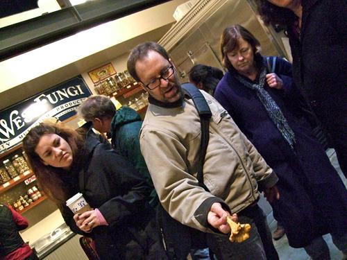 Eric Tucker holding a Chanterelle mushroom