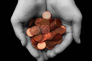 cupped hands holding pennies
