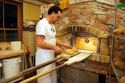 Eduardo Morrell monitors the internal temperature of the bread to gauge its readiness