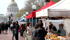 Customers shop for fresh vegetables at a farmers market on March 16, 2011 in San Francisco.