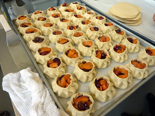 Tray of apricot and cherry tarts