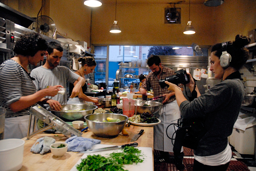 Mirra Fine filming Perennial Plate dinner prep in Tartine Bakery kitchen. Photo by Wendy Goodfriend