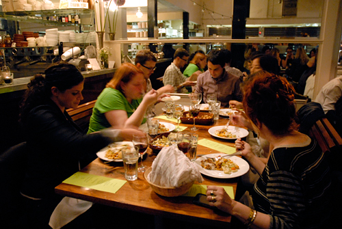 Guests feast at The Perennial Plates Harvest dinner at Tartine Bakery in San Francisco. Photo by Wendy Goodfriend