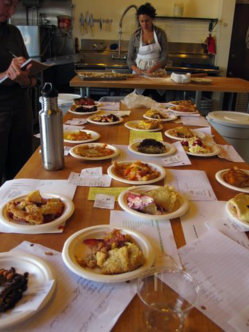 With 20 pies on the table, Judge Patricia Hewitt has got to take careful notes.