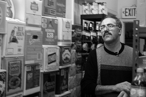Yousef Elhaj, corner store owner, in his San Francisco shop. Image: Katherine Bruens, 2009
