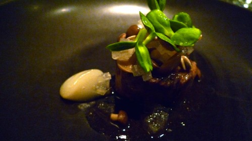 beef braised in pear, beech mushroom, sunflower seeds and leaves