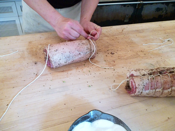 Damon LIttle tying pancetta.