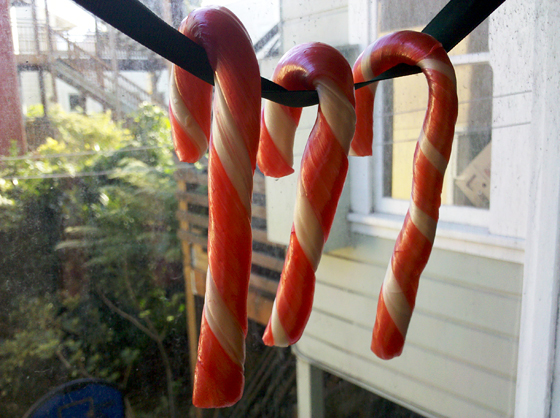 Candy Canes hanging on ribbon