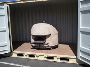 Wood-burning Stefano Ferrara oven in container. Photo courtesy of Del Popolo