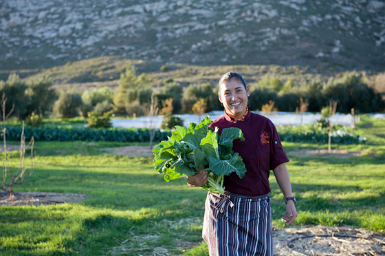 La Cocina que Conta chef Denise Roa in the ranch's organic garden. Photo: Lynne Harty